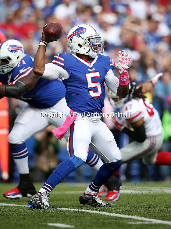 Buffalo Bills quarterback Tyrod Taylor (5) throws a second quarter pass during the 2015 NFL week 4 regular season football game against the New York Giants on Sunday, Oct. 4, 2015 in Orchard Park, N.Y. The Giants won the game 24-10. (©Paul Anthony Spinelli)