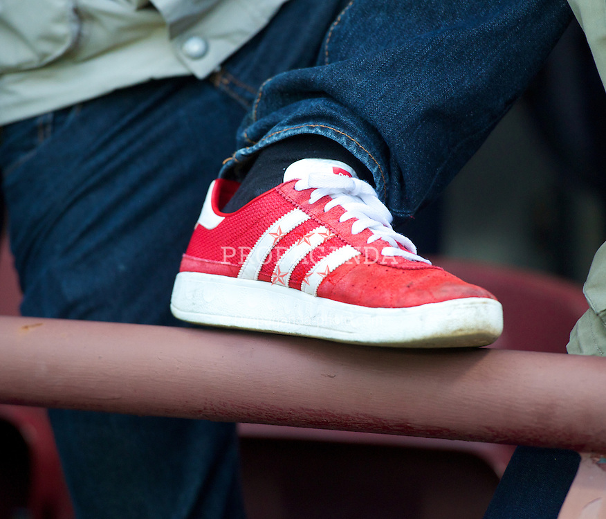 EDINBURGH, SCOTLAND - Thursday, August 23, 2012: Liverpool supporters wearing 'casuals' and Adidas red Munchen shoes before the UEFA Europa League Play-Off Round 1st Leg match against Heart of Midlothian at Tynecastle. (Pic by David Rawcliffe/Propaganda)