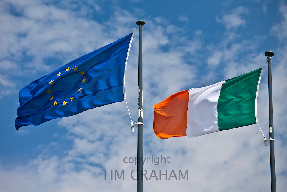 Irish green white and gold stripes flag and European Union EU blue flag with gold stars, County Clare, West of Ireland