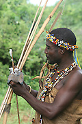 Africa, Tanzania, Lake Eyasi, Hadza male with a bird spiked on an arrow Small tribe of hunter gatherers AKA Hadzabe Tribe April 2006