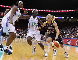 June 3, 2012; Newark, NJ, USA; Indiana Fever guard Erin Phillips (13) dribbles the ball while being defended by New York Liberty forward Essence Carson (17) and New York Liberty forward Kara Braxton (45) during the second half at the Prudential Center. The Liberty defeated the Fever 87-72.