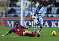 Photo: Lee Earle.<br /> Coventry City v Crystal Palace. Coca Cola Championship. 13/01/2007.Palace's Carl Fletcher slides in on Stern John.