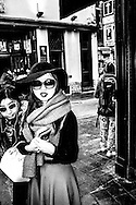 April 2015. Brussels. Asian girls visiting the Manneken pis statue, one of the most famouse icons of the city.