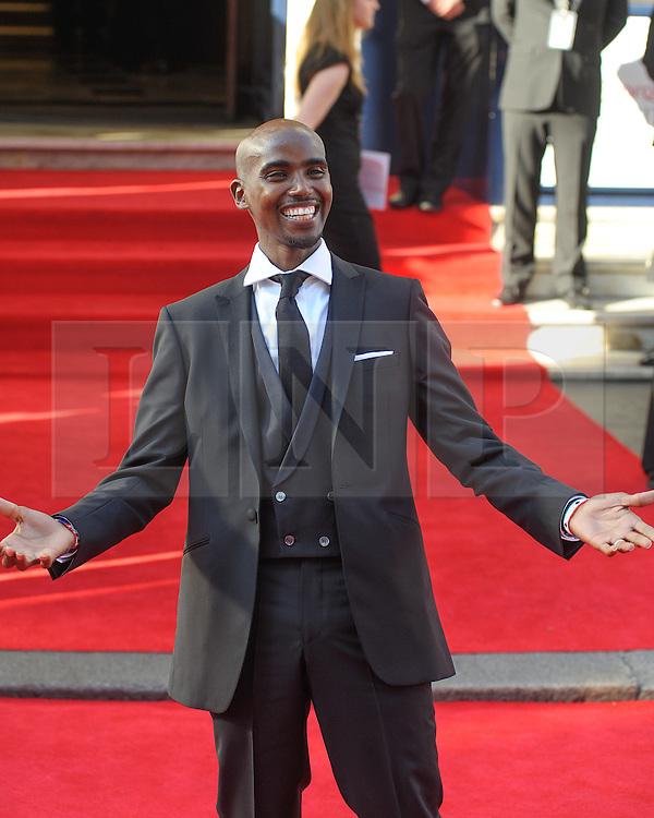 "© Licensed to London News Pictures. 18/05/2014. London, UK. The Arqiva BAFTA TV Awards Red Carpet Arrivals. . Persons Pictured: Mohamed ""Mo"" Farah. Photo credit : Julie Edwards/LNP"