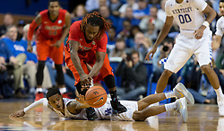 Kentucky guard Tyler Ulis, bottom, scrambles for a loose ball with Ole Miss guard Stefan Moody in the first half. The University of Kentucky hosted Ole Miss, Saturday, Jan. 02, 2016 at Rupp Arena in Lexington.