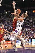Kansas State guard Shalee Lehning (right center) drives to the basket against Iowa State's Lisa Bildeaux (behind) in the second half at Bramlage Coliseum in Manhattan, Kansas, February 11, 2006.  The Cyclones defeated the Wildcats 71-66.