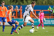 Forest Green Rovers Darren Carter (12) passes the ball during the Vanarama National League match between Braintree Town and Forest Green Rovers at the Amlin Stadium, Braintree, United Kingdom on 24 September 2016. Photo by Shane Healey.