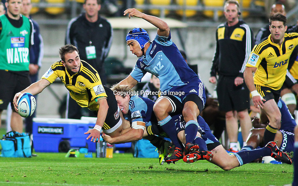 Andre Taylor looks to offload in a tackle during their Super Rugby match, Hurricanes v Blues, Westpac stadium, Wellington, New Zealand. Friday 4 May 2012.  PHOTO: Grant Down / photosport.co.nz