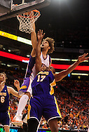 May 23, 2010; Phoenix, AZ, USA; Phoenix Suns center Robin Lopez (15) puts up a shot against Los Angeles Lakers center Andrew Bynum (17) during the first quarter in game three of the western conference finals in the 2010 NBA Playoffs at US Airways Center.  Mandatory Credit: Jennifer Stewart-US PRESSWIRE