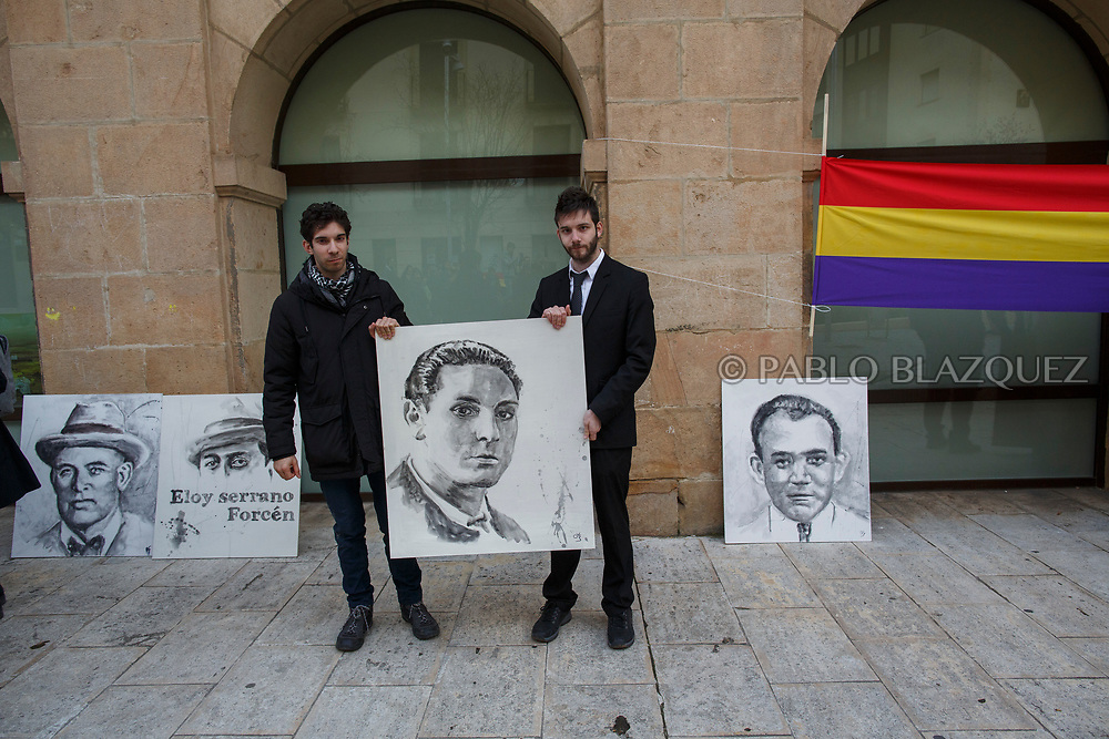 14/04/2018. Gran nephews Alberto (L) and Alvaro (R) Rodriguez Garcia hold a portrait depicting Spain's Civil war victim Elicio Gomez during a homage to hand victims of Spain Civil War bodies exhumed in Cobertelada and Calata&ntilde;azor to their relatives on April 14, 2018 in Soria, Spain. La Asociacion Soriana Recuerdo y Dignidad (ASRD) 'The Soria Association for Memory and Dignity' celebrated a tribute to hand over the remains of civil war victims to their families. The Society of Sciences of ARANZADI helped with the research, exhumation and identification of the bodies, after villagers passed the information about the mass grave, 81 years after the assassination took place, to the ASRD. Seven people were assassinated around August 25, 1936 by Falangists, as part of General Francisco Franco armed forces, and buried in the 'Fosa de los Maestros' (Teachers Mass Grave) near Cobertelada, Soria, after being taken from prison of Almazan during the Spanish Civil War. Five of them were teachers in the region, and also friends of Spanish writer Antonio Machado. The other two still remain unidentified. Another body was assassinated by Falangists accompanied by a priest in 1936, and was exhumed on 23 September of 2017 near Calata&ntilde;azor, Soria. It belonged to Abundio Andaluz, a politician, lawyer and musician in Soria.<br /> Spain's Civil War took the lives of thousands of people on both sides, and civilians. But Franco continued his executions after the war has finished. Teachers, as part of the education sector, were often a target of Franco's forces. Spanish governments has never done anything to help the victims of the Civil War and Franco's dictatorship while there are still thousands of people missing in mass graves around the country. (&copy; Pablo Blazquez)