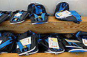 """Backpacks filled with donated books await their new owners at a celebration of the """"Help Me Read"""" program at Enrico Fermi Elementary School No. 17 in Rochester on Monday, June 2, 2014. The tutoring program helped 137 children improve their reading ability, with some students making jumps of several grade levels in one year."""