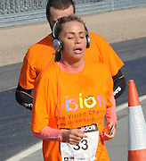 06.MARCH.2011 NORTHAMPTONSHIRE<br /> <br /> KATIE PRICE RUNS THE SILVERSTONE HALF MARATHON FOR VISION CHARITY ORGANISATION.<br /> <br /> BYLINE: EDBIMAGEARCHIVE.COM<br /> <br /> *THIS IMAGE IS STRICTLY FOR UK NEWSPAPERS AND MAGAZINES ONLY*<br /> *FOR WORLD WIDE SALES AND WEB USE PLEASE CONTACT EDBIMAGEARCHIVE - 0208 954 5968*