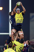 Marius Sirbe (R) of Romania tries to stop Louis Stanfill  (L) of USA during their  rugby test match, on National Stadium Arc de Triomphe in Bucharest, November 8, 2014.