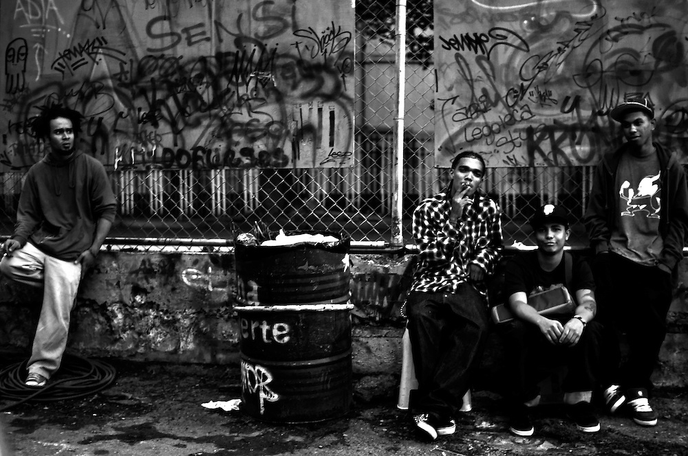 "Members of the ""SDN"" graffiti gang hang out sketching and smoking cigarettes in Del Valle, a slum on the outskirts of Caracas, Venezuela."