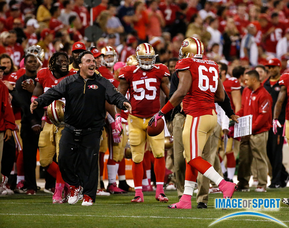Oct 6, 2013; San Francisco, CA, USA;  San Francisco 49er defensive tackle Tony Jerod-Eddy (63) is congratulated by defensive line coach Jim Tomsula (left) following his interception during game against Houston Texans at Candlestick Park. The 49ers defeated the Texans 34-3.