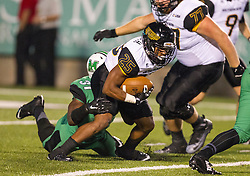 Oct 9, 2015; Huntington, WV, USA; Southern Miss Golden Eagles running back Ito Smith is stopped in the back field by Marshall Thundering Herd linebacker Evan McKelvey during the third quarter at Joan C. Edwards Stadium. Mandatory Credit: Ben Queen-USA TODAY Sports