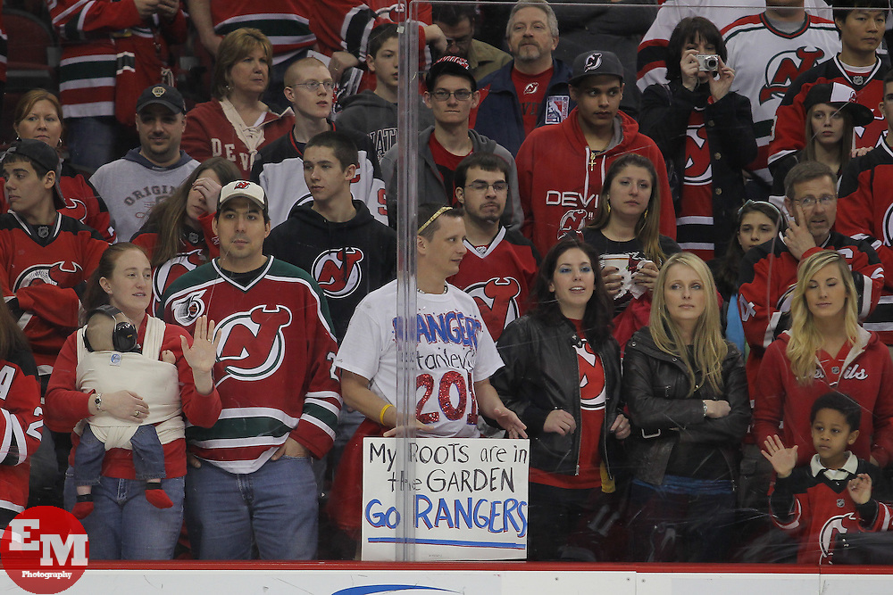 Apr 7; Newark, NJ, USA; A lone New York Rangers fan holds up a sign in support during the pre game warmups for the game between the New Jersey Devils and the Ottawa Senators at the Prudential Center.