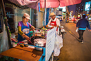 "02 OCTOBER 2012 - BANGKOK, THAILAND:  A street food vendor on Soi 22 in central Bangkok, Thailand. Thailand in general, and Bangkok in particular, has a vibrant tradition of street food and ""eating on the run."" In recent years, Bangkok's street food has become something of an international landmark and is being written about in glossy travel magazines and in the pages of the New York Times.         PHOTO BY JACK KURTZ"