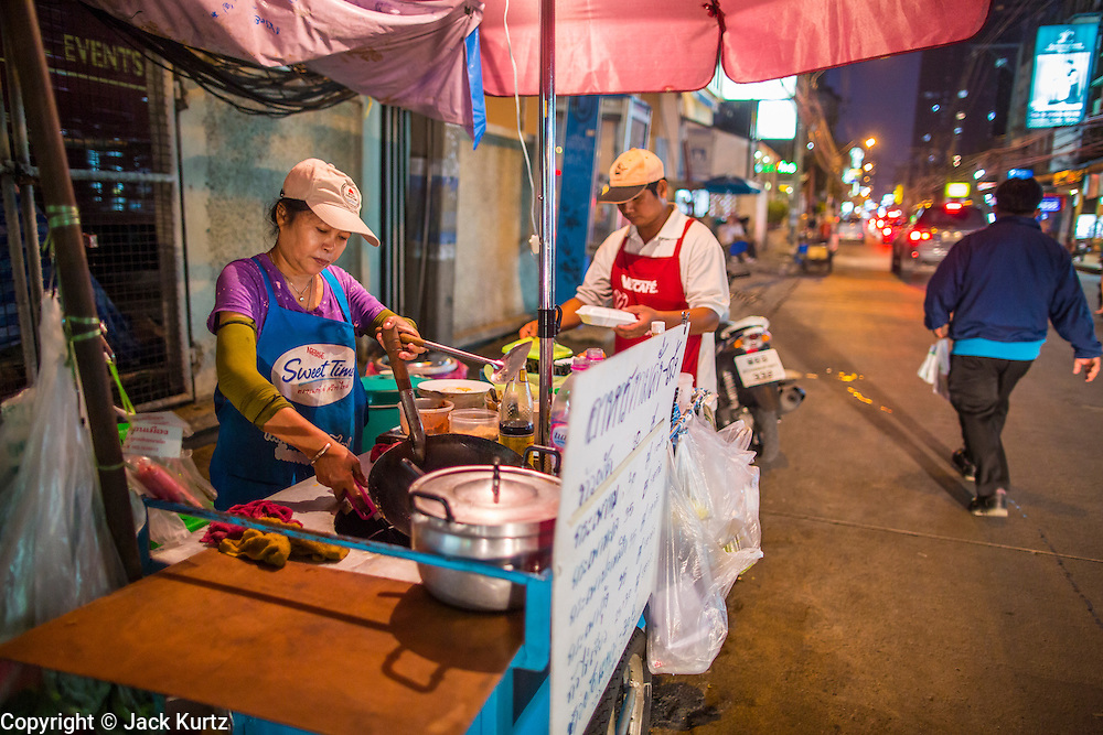 """02 OCTOBER 2012 - BANGKOK, THAILAND:  A street food vendor on Soi 22 in central Bangkok, Thailand. Thailand in general, and Bangkok in particular, has a vibrant tradition of street food and """"eating on the run."""" In recent years, Bangkok's street food has become something of an international landmark and is being written about in glossy travel magazines and in the pages of the New York Times.         PHOTO BY JACK KURTZ"""