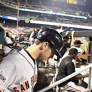 Buster Posey, San Francisco Giants, in the dugout preparing to bat during the New York Mets Vs San Francisco Giants MLB regular season baseball game at Citi Field, Queens, New York. USA. 11th June 2015. Photo Tim Clayton