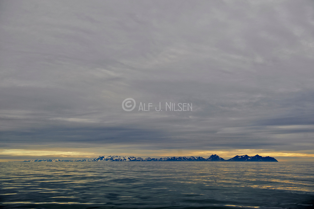 The large island and national park  Prins Karls Forland situated on the western Spitsbergen, here seen against the horizon from Krossfjord in August 2012.