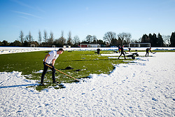 Staff from Bristol Sport and Ashton Gate join the Groundsmen to help clear the Bristol City training pitches at Failand of snow - Rogan/JMP - 28/12/2017 - Failand - Bristol, England - Sky Bet Championship.