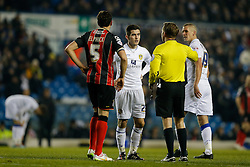 Lewis Cook of Leeds United is spoken to by referee Oliver Langford before being shown a yellow card - Photo mandatory by-line: Rogan Thomson/JMP - 07966 386802 - 20/01/2015 - SPORT - FOOTBALL - Leeds, England - Elland Road Stadium - Leeds United v Bournemouth - Sky Bet Championship.