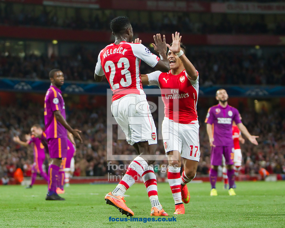 Danny Welbeck of Arsenal is congratulated by Alexis Sanchez after Scoring against Galatasaray during the UEFA Champions League match at the Emirates Stadium, London<br /> Picture by John Rainford/Focus Images Ltd +44 7506 538356<br /> 01/10/2014