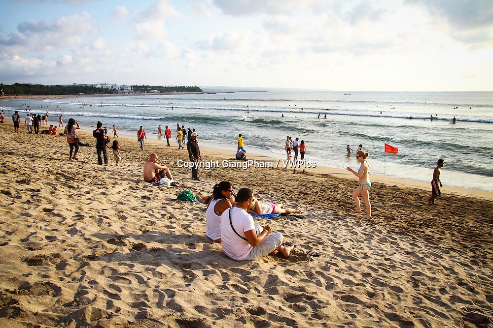 People enjoy life on Kuta Beach, Bali, Indonesia
