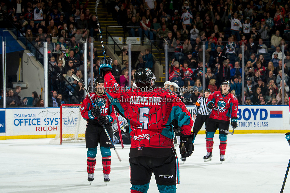 KELOWNA, CANADA - MARCH 16: Cayde Augustine #5 of the Kelowna Rockets celebrates his second goal of the season during first period against the Vancouver Giants  on March 16, 2019 at Prospera Place in Kelowna, British Columbia, Canada.  (Photo by Marissa Baecker/Shoot the Breeze)
