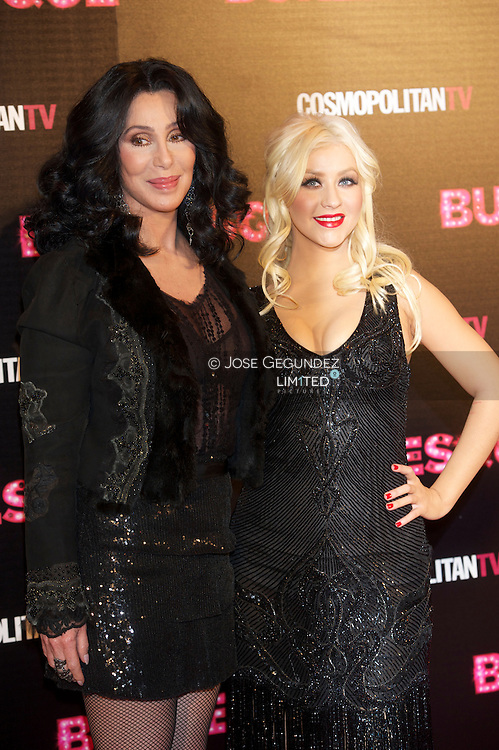 Cher (L) and Christina Aguilera (R) attend 'Burlesque' premiere at Callao cinema on December 9, 2010 in Madrid, Spain.