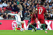 England forward, Wayne Rooney (10) battles for possesion with Portugal midfielder, Joao Moutinho (08) during the Friendly International match between England and Portugal at Wembley Stadium, London, England on 2 June 2016. Photo by Matthew Redman.