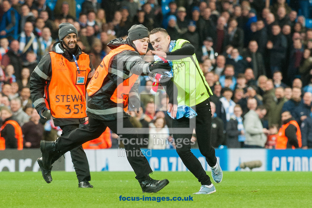 A pitch invader evades a steward during the UEFA Champions League match at the Etihad Stadium, Manchester<br /> Picture by Matt Wilkinson/Focus Images Ltd 07814 960751<br /> 21/02/2017