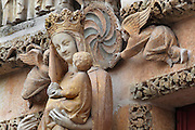 The Vierge Doree or Golden Virgin, statue of Mary with Christ child and 3 angels, 1245, on the South portal or St Honore portal on the South transept of the Basilique Cathedrale Notre-Dame d'Amiens or Cathedral Basilica of Our Lady of Amiens, built 1220-70 in Gothic style, Amiens, Picardy, France. St Honore or Honoratus was the 7th bishop of Amiens who lived in the 6th century AD. Amiens Cathedral was listed as a UNESCO World Heritage Site in 1981. Picture by Manuel Cohen