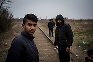 A 15 years old migrants is seen walking with other Pakistan migrants on a rail road not far from Subotica headed to the Hungarian border, they will wait the night and try to cross. probably with the help of smugglers. Subotica, Serbia. March 18th, 2017. Federico Scoppa/CAPTA