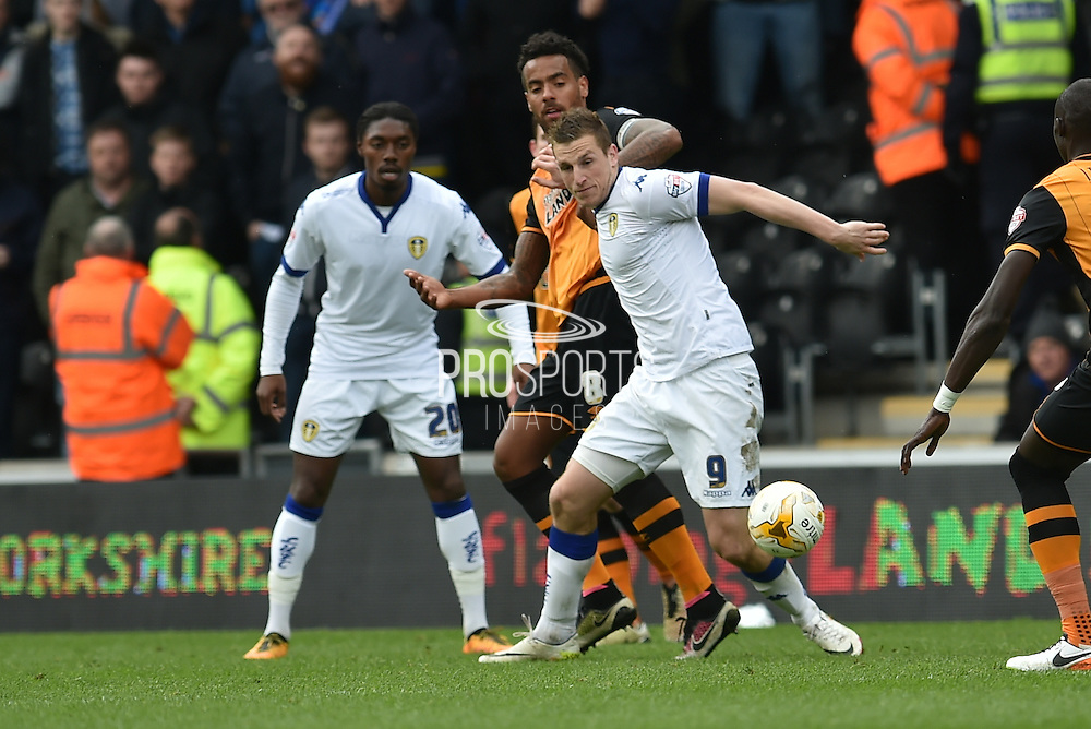 Chris Wood (9) takes ball from Hull City midfielder Tom Huddlestone (8) during the Sky Bet Championship match between Hull City and Leeds United at the KC Stadium, Kingston upon Hull, England on 23 April 2016. Photo by Ian Lyall.