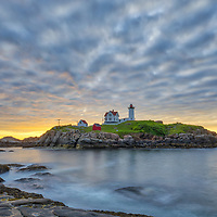 Nuble Lighthouse captured at sunrise in York, ME. Loved viewing this Maine sunrise and capturing the first light at one of New England's most scenic lighthouses, Cape Neddick Lighthouse.<br />