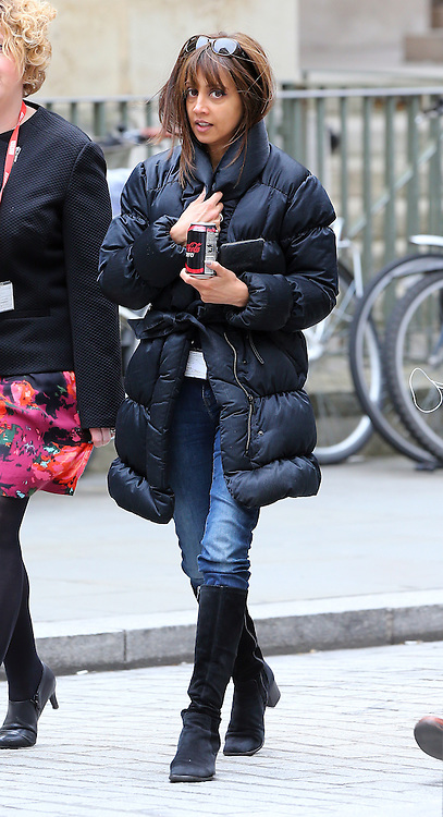 Journalist/Newsreader Riz Lateef wearing a black puffa jacket, jeans and a pair of knee high boots at the BBC studios in central London, UK. 01/04/2015<br />