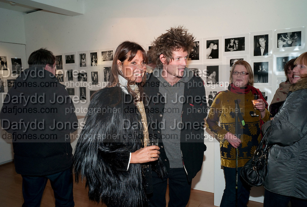COUNTESS DEBBIE VON BISKARCK; NICOLAI VON BISMARCK, The Way We Wore.- Photographs of parties in the 70's by Nick Ashley. Sladmore Contemporary. Bruton Place. London. 13 January 2010. *** Local Caption *** -DO NOT ARCHIVE-© Copyright Photograph by Dafydd Jones. 248 Clapham Rd. London SW9 0PZ. Tel 0207 820 0771. www.dafjones.com.<br /> COUNTESS DEBBIE VON BISKARCK; NICOLAI VON BISMARCK, The Way We Wore.- Photographs of parties in the 70's by Nick Ashley. Sladmore Contemporary. Bruton Place. London. 13 January 2010.