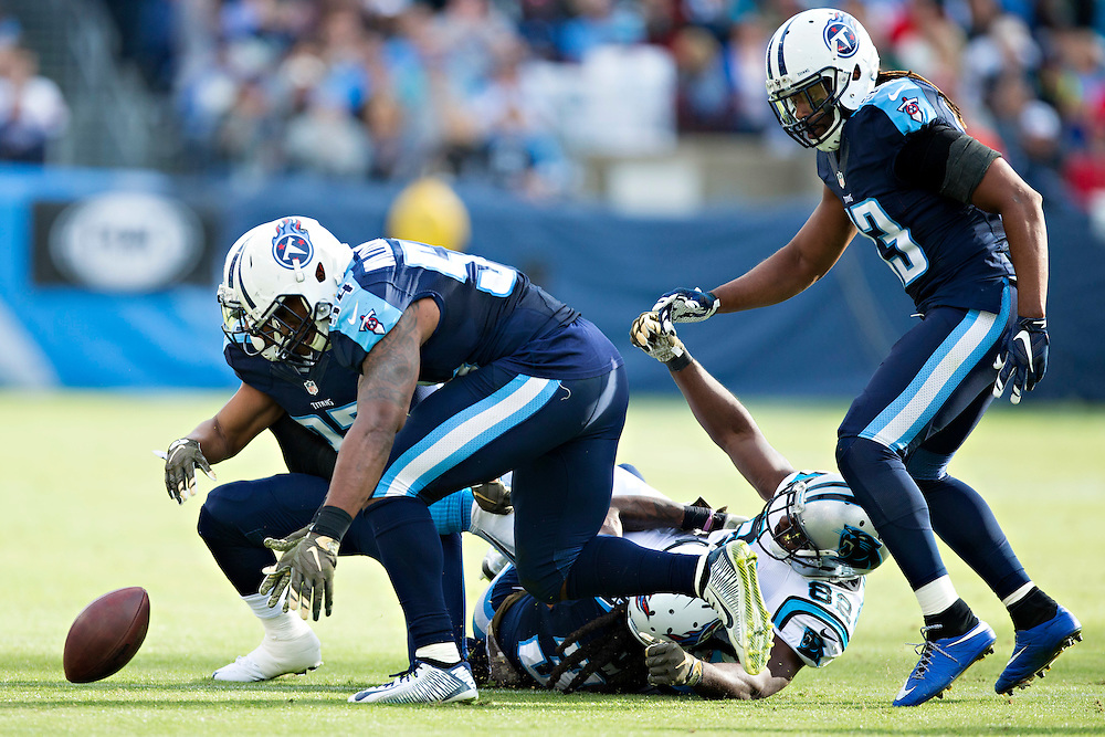 NASHVILLE, TN - NOVEMBER 15:  Cody Riggs #37, Avery Williamson #54 and B.W. Webb #38 of the Tennessee Titans tackle Jerricho Cotchery #82 of the Carolina Panthers and force a fumble at Nissan Stadium on November 15, 2015 in Nashville, Tennessee.  (Photo by Wesley Hitt/Getty Images) *** Local Caption *** Cody Riggs; B.W. Webb; Jerricho Cotchery; Avery Williamson