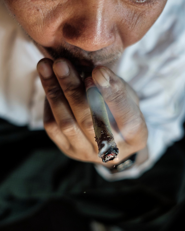 20170222 Shan state<br /> A village chief smokes fresh opium pasted on a locally produced cigarr in Shan State, Myanmar.<br /> Photo: Vilhelm Stokstad / Kontinent