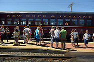 LANSDALE, PA - AUGUST 24: Passengers wait to board the New Hope and Ivyland Railroad during Founders Day August 24, 2013 in Lansdale, Pennsylvania. The New Hope and Ivyland Railroad made special trips as part of Founders Day from Lansdale to Souderton. (Photo by William Thomas Cain/Cain Images)