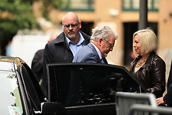 Licensed to London News Pictures. London, UK. 04/06/2014. Former BBC TV entertainer ROLF HARRIS arrives at Southwark Crown Court in London today (04/06/2014) with his daughter Bindi Harris, right, as the trial continues for 12 charges of indecent assault.