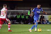 AFC Wimbledon midfielder Liam Trotter (14) dribbling and taking on Stevanage attacker Ben Kennedy (10) during the EFL Trophy group stage match between AFC Wimbledon and Stevenage at the Cherry Red Records Stadium, Kingston, England on 6 November 2018.