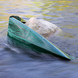 A canoe wrapped around a rock below Chesterfield Gorge on the West Branch of the Westfield River in Chesterfield, Massachusetts.