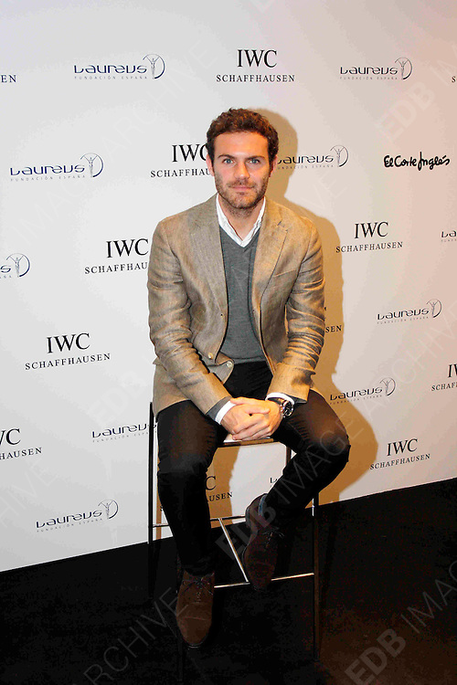 08.OCTOBER.2012. MADRID<br /> <br /> CHELSEA AND SPAIN FOOTBALLER JUAN MATA BEING PRESENTED WITH THE 'IWC PORTOFINO CHRONOGRAPH LAUREUS' WATCH. THE SALES OF THIS WATCH WILL BE DESTINED TO THE CHARITY PROJECT 'FOR OUR HEROES', OF THE LAUREUS FOUNDATION SPAIN.<br /> <br /> BYLINE: EDBIMAGEARCHIVE.CO.UK<br /> <br /> *THIS IMAGE IS STRICTLY FOR UK NEWSPAPERS AND MAGAZINES ONLY*<br /> *FOR WORLD WIDE SALES AND WEB USE PLEASE CONTACT EDBIMAGEARCHIVE - 0208 954 5968*