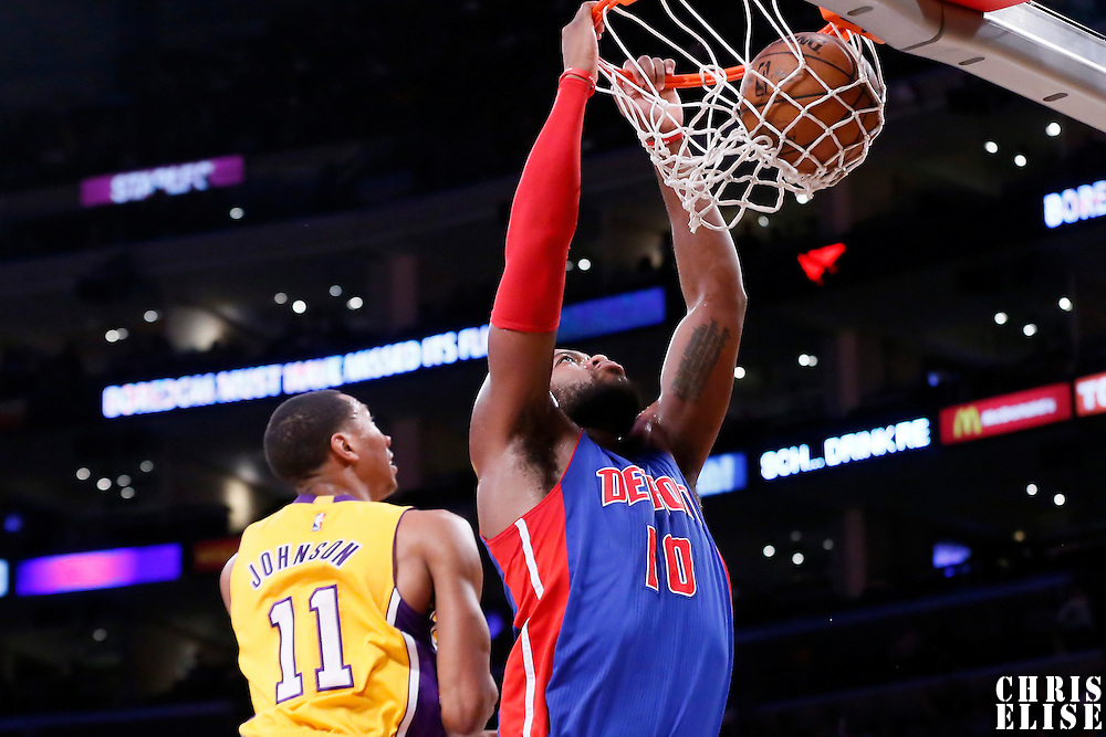 10 March 2015: Detroit Pistons forward Greg Monroe (10) goes for the dunk past Los Angeles Lakers forward Wesley Johnson (11) during the Los Angeles Lakers 93-85 victory over the Detroit Pistons, at the Staples Center, Los Angeles, California, USA.
