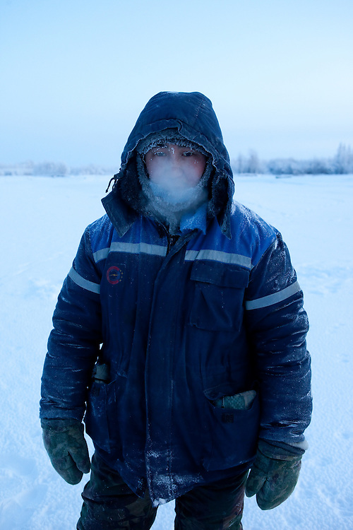 The Pole of Cold. Portrait of a local fisherman close to the  village of Tomtor. The area is extremely cold during the winter. Two towns by the highway, Tomtor and Oymyakon, both claim the coldest inhabited place on earth (often referred to as -71.2°C, but might be -67.7°C) outside of Antarctica. The average temperature in Oymyakon in January is -42°C (daily maximum) and -50°C (daily minimum). The images had been made during an outside temperature in between -50°C up to -55°C. Tomtor, Jakutien, Yakutia, Russian Federation, Russia, RUS, 20.01.2010