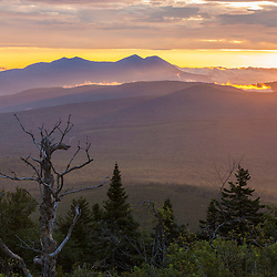 Sunrise view over the Reddington Forest of the Bigelow Range (left) from Quill Hill in Reddington Township, Maine. Appalachian Trail.