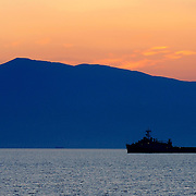 The amphibious transport dock USS Ponce (LPD 15) rests anchored off the coast of Volos, Greece, in the early morning hours before participating in a joint amphibious exercise with the amphibious dock landing ship USS Fort McHenry (LSD 43) and the Greek military and police force. USS Fort McHenry is currently on a scheduled deployment with the Bataan Amphibious Readiness Group (ARG) in support of maritime security operations in the U.S. 5th and 6th Fleet areas of responsibility.